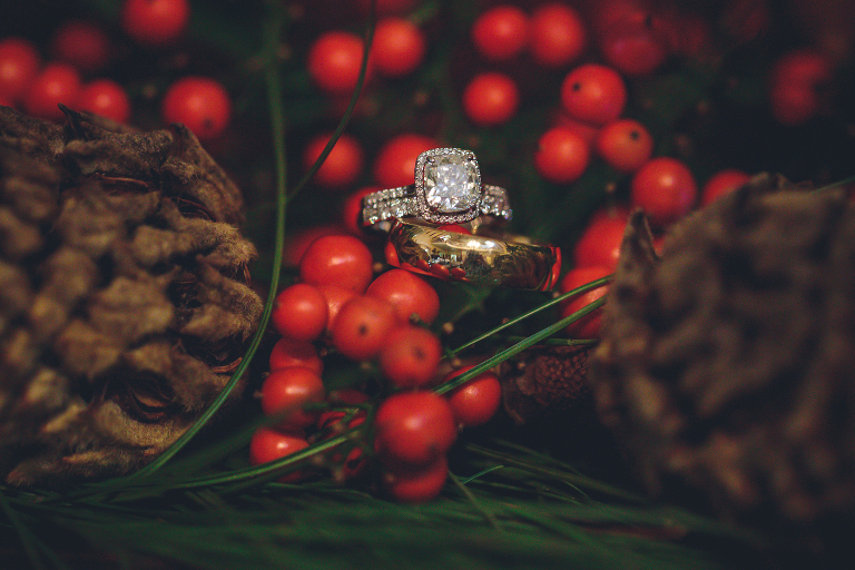 wedding rings in christmas red berries