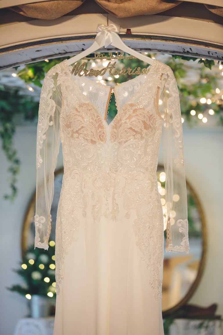 beautiful wedding dress hanging in the Rose Cottage at Shiloh Farm