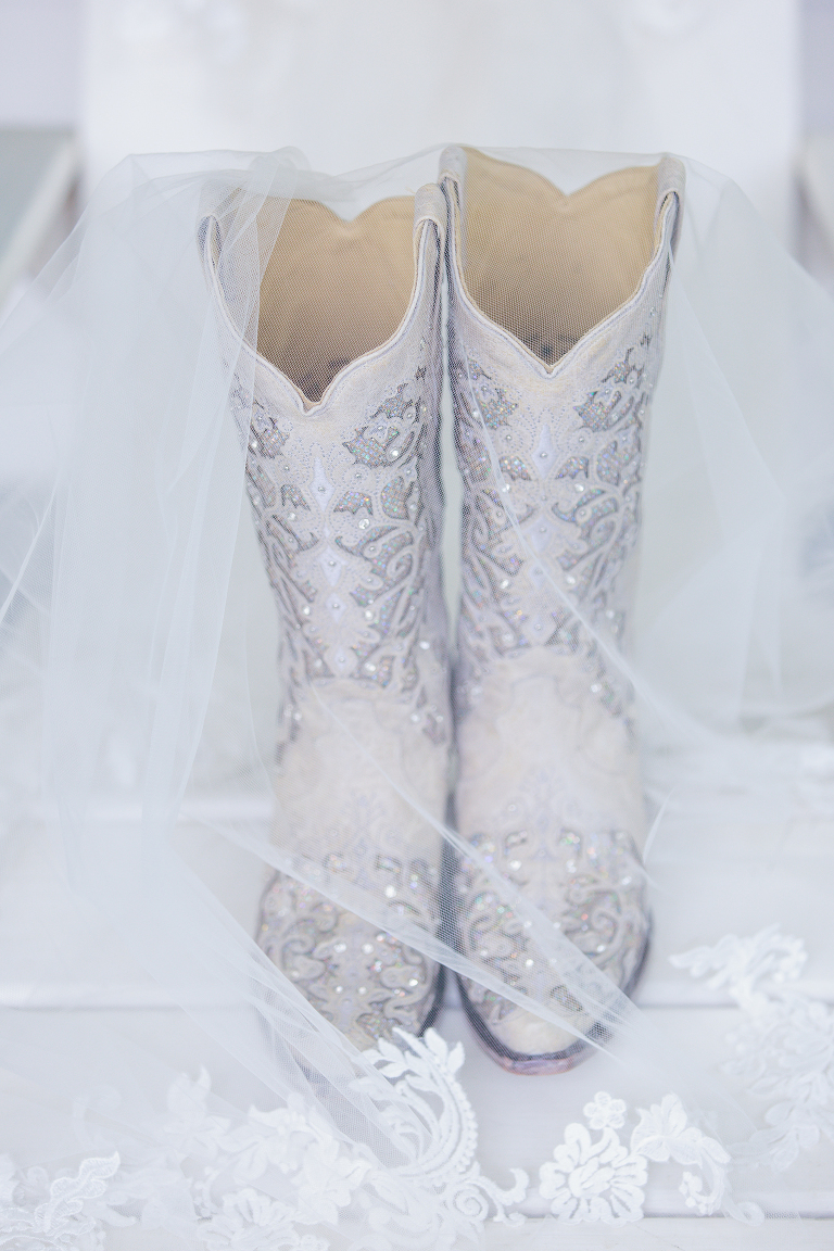 boots that the bride will wear with veil over them